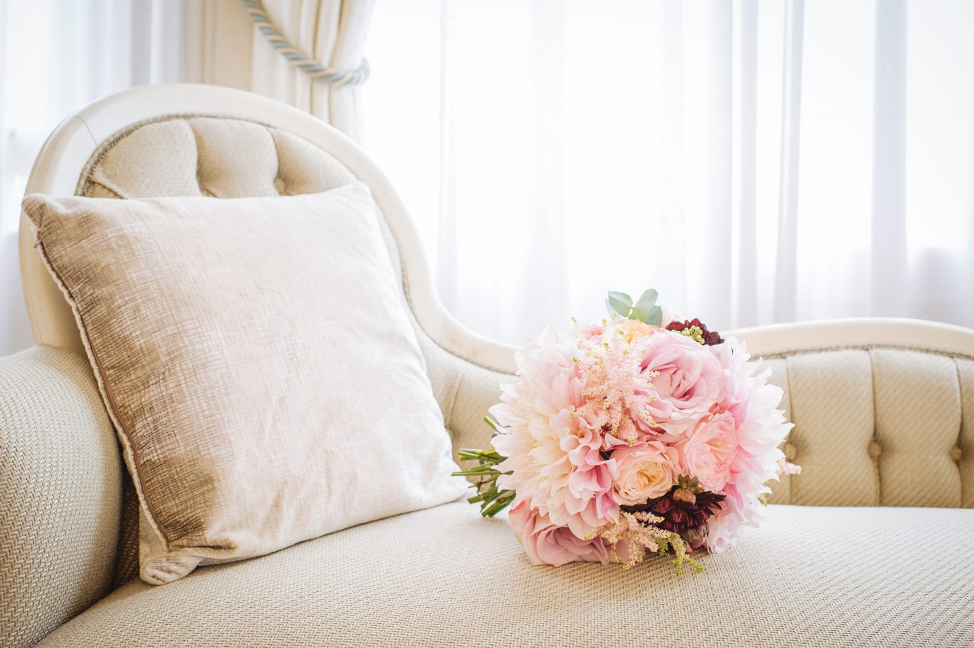 Beautiful blush and pink bridal bouquet laying on a chair