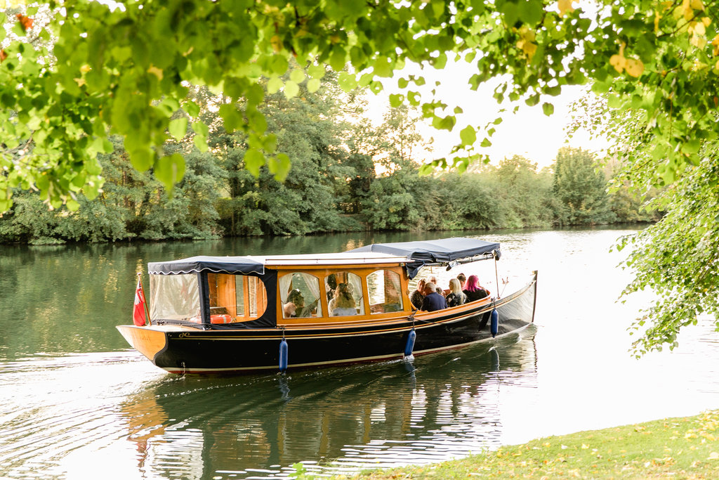Boat sailing down the River Thames at Cliveden House Hotel